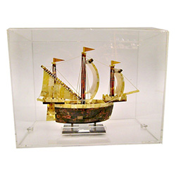 Hand made replica of an 18th century sailing ship made from amber.  Mounted in a plexiglass display case.   Exquisite hand craftsmanship.  Unique and very beautiful.