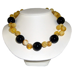 "A stunning combination of medium amber and large onyx beads artistically woven together in multi-strands.  Adjusts to three lengths: 22"" , 19"" and 17""."