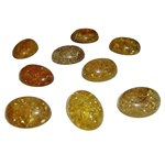 "Approx .5"" x .75"" x .25: thick - 15mm x 20mm x 7mm thick.  These oval domed amber cabochons are quite sparkly.  Price is per piece."