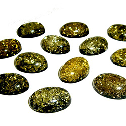 "Approx .5"" x .75"" x .25: thick - 15mm x 20mm x 6mm thick.  These oval domed amber cabochons have backs painted black which produces their green color.  Price is per piece."