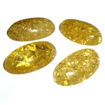 "Approx .56"" x 1"" x .25"" thick - 15mm x 25mm x 6mm thick.  These oval domed amber cabochons have backs painted black which produces their green color.  Price is per piece."