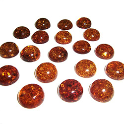 "Approx .5"" x .25"" thick - 10mm x 6mm thick.  These are round domed amber cabochons.  Price is per piece."