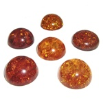 "Approx .75"" x .31"" thick - 20mm x 10mm thick.  These are round domed amber cabochons.  Price is per piece."