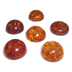 "Approx .68"" x .31"" thick - 17mm x 10mm thick.  These are round domed amber cabochons.  Price is per piece."