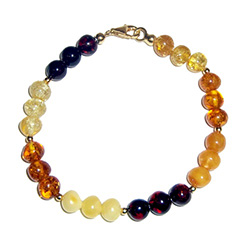 Round amber stones in sets of three colors separate by golden miniature spheres.