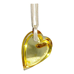 Exquisite amber heart pendant filled with tiny Czech Signity Cubic Zirconia crystals.  This pendant is composed of two pieces of clear heart shaped amber slices to create a chamber into which the artist has poured tiny Czech crystals