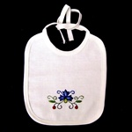 Hand embroidered Kashubian flowers on a child's cotton bib.