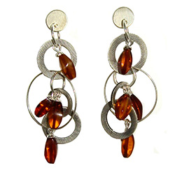 Amber beads and silver discs combine to make one very cute set of earrings!  Note that the silver discs are printed with a pattern that gives them a matte type finish.