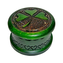 Beautiful Polish craftsmanship with an Irish theme.  Round box with shamrock design, metal inlay accents and vibrant green finish.