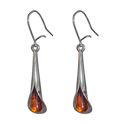 Drops of honey amber wrapped in silver in a calla lily shape.  Stylish and unique.
