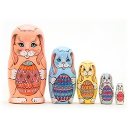 These bunnies would love to hop into your child's Easter basket! The 5 rabbits in this set nest together. Each is brightly colored and holding a traditional Ukrainian Pisanke Easter egg. A great gift for Easter or your favorite rabbit lover! A great matry