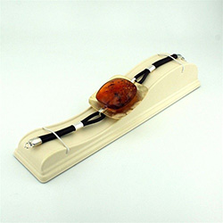 Beautiful slab of natural amber mounted on a silver band with a background of brushed gold plate over silver.  The cord in this picture appears black but it is a chocolate brown.