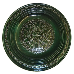 Polish wooden plates are made from Linden wood in the mountain region of southern Poland called Podhale.  The plates are cut and shaped on a lathe by hand.  The floral designs are burned into the wood before staining and varnishing. All the flowers are su
