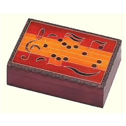 This beautiful box is made of seasoned Linden wood, from the Tatra Mountain region of Poland and a mushroom patch burned into the top. The treble clef, the key of B flat, and a variety of notes decorate the lid of this box. Metal inlays enhance the design