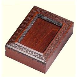 "An absolutely beautiful box!  Walnut stained box with detailed picture frame on the beveled top. Frame has a opening on one side to slide in a photo, but this box is just as beautiful as is. Made for wallet size photos: 3.5"" x 5"".