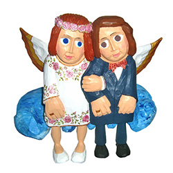Our happy couple are sitting on a cloud in Heaven.	 This piece is designed to sit on a shelf.   Signed by the artist. Master carver Waldemar Styperek is best known for his beautiful carvings of angels.