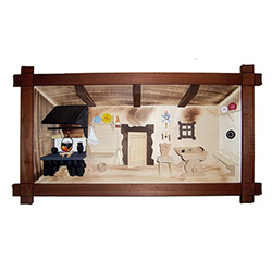 Poland has a long history of craftsmen working with wood in southern Poland. Their workshops produce beautiful hand made boxes, plates and carvings.  This shadow box is a look inside a traditional Polish farmer's cottage. Note the nice attention to detail