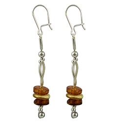 Precious-looking set of dangle earrings, consisting of a multi-colored stacked set of amber discs, with a French hook attachment and strung on two pieces of artistic silver.