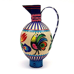 Decorating eggs with paper cuts is a tradition from the Lowicz region of central Poland. Cleverly created to make a folk jug.