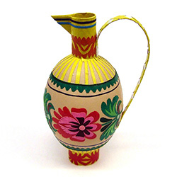 Decorating eggs with paper cuts is a tradition from the Lowicz region of central Poland.  Cleverly created to make a folk jug. Hand made by master artist Danuta Wojda. Assorted designs and colors.  No two are exactly alike.