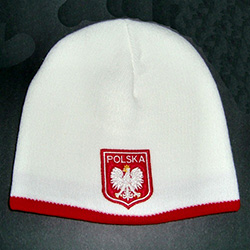 "Display your Polish heritage!  Red and white stretch ribbed-knit skull cap, which the Polish emblem under the word ""Polska"" (Poland).  Easy care acrylic fabric.  One size fits all.   Imported from Poland."