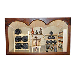 Poland has a long history of craftsmen working with wood in southern Poland. Their workshops produce beautiful hand made boxes, plates and carvings.  This shadow box is a look inside a traditional winery.
