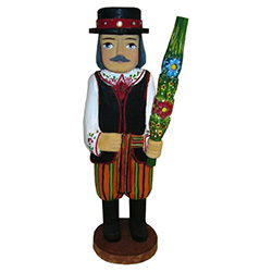 Our man from Lowicz is in full costume and carrying a Polish Easter palm.  In Poland Easter palms are made from dried woven flowers and are very colorful.  Carved and painted by Z. Suchinski.