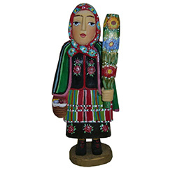 Our Pani from Lowicz is in full costume and carrying a Polish Easter palm.  In Poland Easter palms are made from dried woven flowers and are very colorful.  Carved and painted by Z. Suchinski.