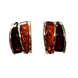 Nicely detailed in sterling silver. Two slices of attractive curve shaped amber cabochons.