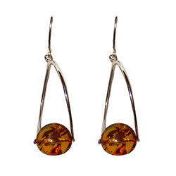 Attractive oval amber suspended in sterling silver.