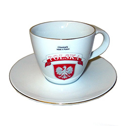 Attractive cup and saucer set with the Polish eagle below a red and white Polska banner.  The rims of the cup and saucer are trimmed in gold.  Hand washing recommended and not for use in the microwave.