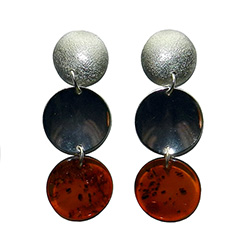 An artistic setting of amber and silver discs.  Silver posts