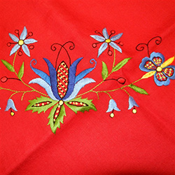 One of the most important highlights of Kashubian art is embroidery. Very subtle and delicate, adapted to the size of the canvas and frequently arranged in the shape of a triangle. Traditional Kashubian embroidery is famous for its wide range of motifs.