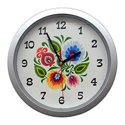 This attractive clock features a center with a traditional Polish paper cut (wycinanka).  Electric battery operated movement.  Easy to hang holder on the back.