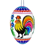 Decorating eggs with paper cuts is a tradition from the Lowicz region of central Poland. Hand made. Assorted designs and colors. No two are exactly alike.