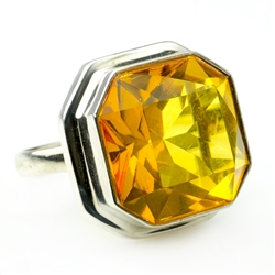 A perfectly cut square piece of faceted cognac colored amber set in sterling silver.