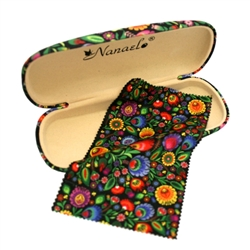 A traditional floral paper cut design from Lowicz on an eye glass case with a matching glass cleaning cloth.