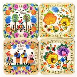 This handsome set of 4 different colorful cork coasters features reproductions of Polish paper cuts both floral and folk.  Please note that there are over 40 different patterns and we cannot guarantee any specific patterns.   Coated with plastic for long