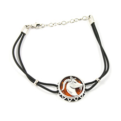 Sterling Silver and Baltic amber Capricorn zodiac sign charm on a durable cord made of black rubber.