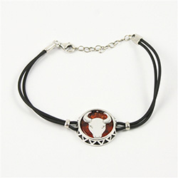 Sterling Silver and Baltic amber Taurus zodiac sign charm on a durable cord made of black rubber.