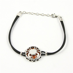 Sterling Silver and Baltic amber Cancer zodiac sign charm on a durable cord made of black rubber.