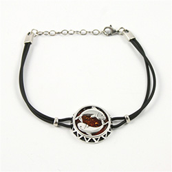 Sterling Silver and Baltic amber Pisces zodiac sign charm on a durable cord made of black rubber.