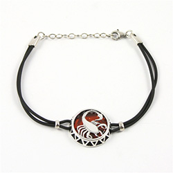 Sterling Silver and Baltic amber Scorpio zodiac sign charm on a durable cord made of black rubber.