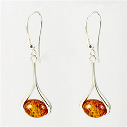 Honey amber wrapped in Sterling Silver teardrops.  Stylish and unique.