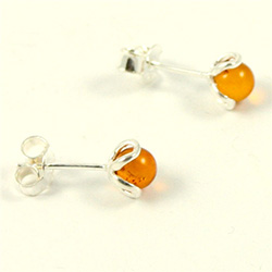 Honey amber spheres studs inside a simple Sterling Silver flower.  Stylish and unique earrings.