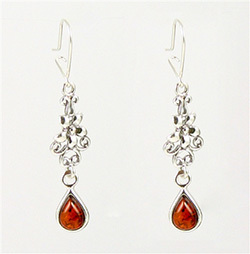 Honey amber tear drops dangling from a Sterling Silver floral design.  Stylish and unique earrings.