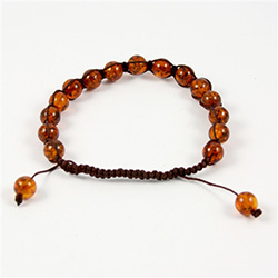 This fine macrame bracelet is made with cognac colored amber.  This bracelet includes dark brown cord and a slide clasp to fit most wrists.