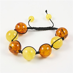 This fine macrame bracelet is made with custard and honey colored amber.  This bracelet includes dark brown cord and a slide clasp to fit most wrists.