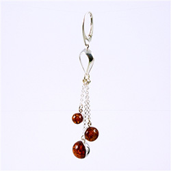 Precious-looking set of dangle earrings, consisting of a three cascading cognac spheres dangling on silver chains.