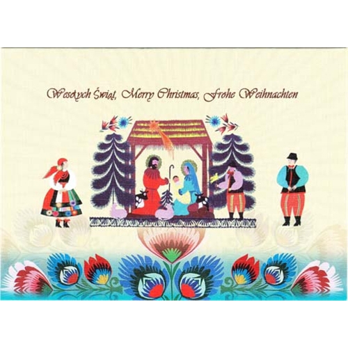 a beautiful glossy christmas card featuring the christmas manger above a polish paper cuts and flanked